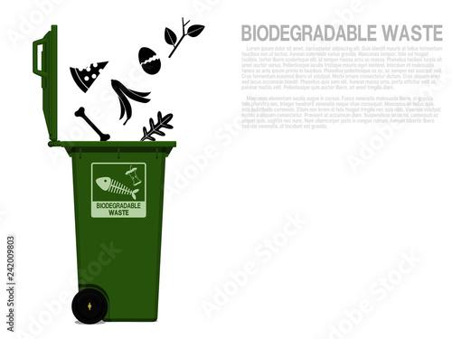 Fotografie, Obraz  Biodegradable waste icon is falling in to the bin
