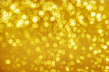 Abstract Yellow Gold Bokeh Bright Glitter Sparkle Glowing Background. For Template Web Advertising Design Brand, Backdrop, Party, New Year Christmas Celebration Etc.