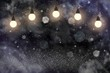 beautiful glossy glitter lights defocused bokeh abstract background with light bulbs and falling snow flakes fly, celebratory mockup texture with blank space for your content