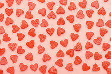 Sweet Sprinkles Of Heart Shapes Over Pink Background, Concept Of St. Valentines Day, Trendy Color Living Coral