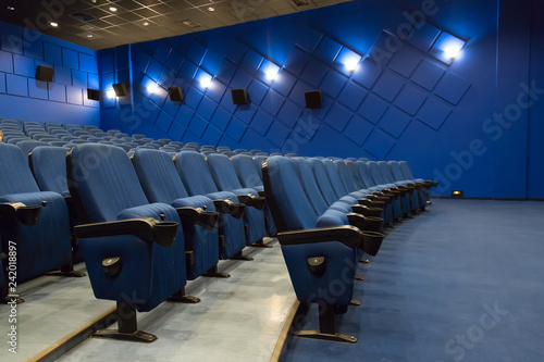 Empty cinema auditorium. Empty rows of blue theater or movie seats
