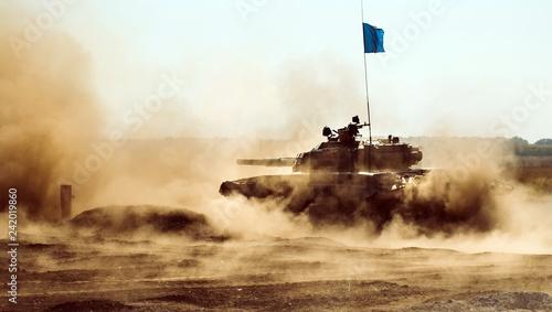Fotografia  Armored Tank rides on off-road