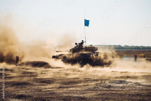 Armored Tank rides on off-road Canvas Print