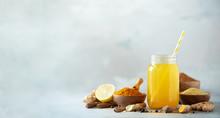 Ingredients For Orange Turmeric Drink On Grey Concrete Background. Lemon Water With Ginger, Curcuma, Black Pepper. Vegan Hot Drink Concept