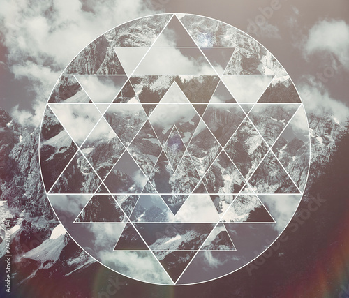 Collage with the mountains landscape and the sacred geometry symbol shri yantra Fototapete