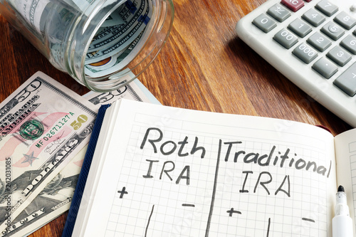 Photo  Roth IRA vs Traditional IRA written in the notepad.