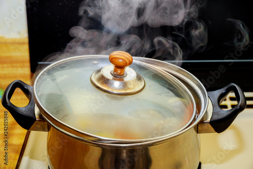 Fotografie, Obraz  Close up boiling pork and chicken soup or boiled water in hot in pot boiling foo
