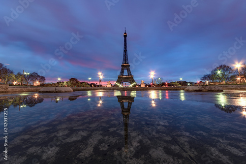 Garden Poster Paris Sunrise on the Eiffel tower reflection on the Trocadero fountain water in Paris, one of the most visited building by the tourists