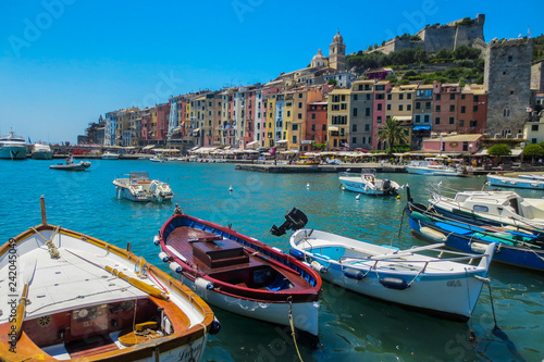 Poster de jardin Europe Méditérranéenne Portovenere, Italy. view of the fishing village of Portovenere from the marina. In the foreground small fishing boats. In the background colorful houses dominated by the walls of the Doria