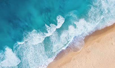 Fototapeta Morze Beach and waves from top view. Turquoise water background from top view. Summer seascape from air. Top view from drone. Travel concept and idea