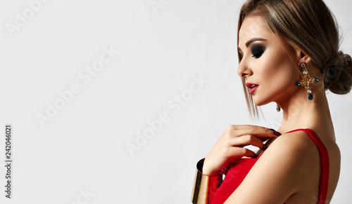 Fotografie, Obraz  Young sensual beautiful woman posing in fashion red dress and big gold bracelet