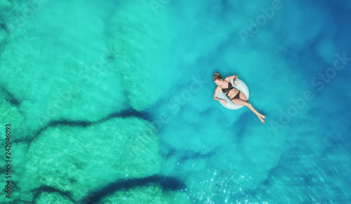 Wall Murals Green coral Aerial view at the girl on sea surface. Beautiful composition at the summer time