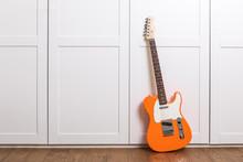 Electric Guitar Standing Near ...