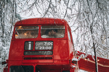 Loving Young Couple Kissing In The Red Bus, Enjoy Each Other