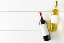 Red And White Wine Bottle On W...