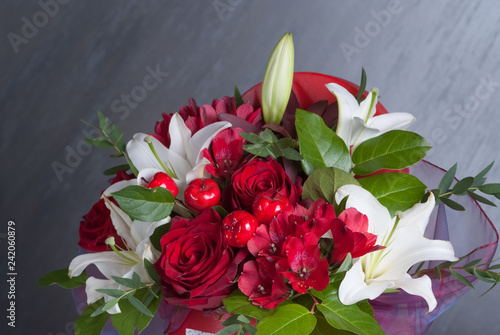 Bouquet of colored flowers in Valentine's day. Red roses. Present for girls and woman