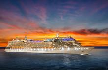 Luxury Cruise Ship Sailing To Port On Sunset.