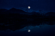 Landscape Of Gorgeous Full Moon Over The Snow-capped Mountains Reflected In The Lake Or Mysterious Night Sky With Full Moon. Azerbaijan