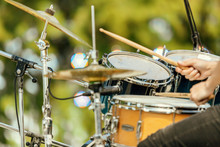 Close-up Of Drums And Drummer's Hands At An Outdoor Recital