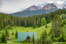 The Picturesque Village Is Located In A Coniferous Mountain Forest.
