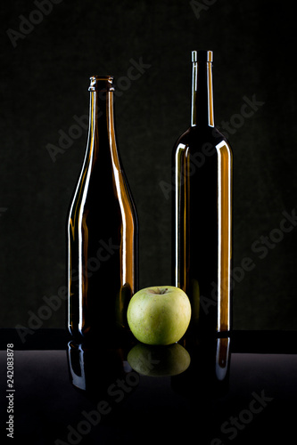 Fotografía  Still Life with an Apple and Glass Bottles