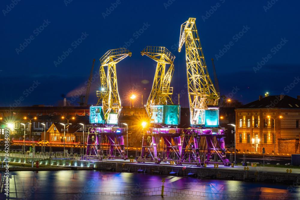 Fototapety, obrazy: Szczecin,Poland-December 2018:Illuminated old port cranes on a boulevard in Szczecin City at night