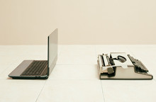 Typewriter And Laptop In Comparing Between Low And High Business Equipment. Concept Of Technology Progress.