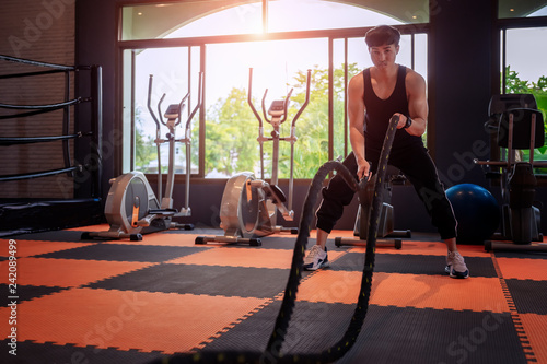 Keuken foto achterwand Ontspanning Young fitness couple in sports dress doing fitness exercise at gym,healthy sports lifestyle,relax concept.