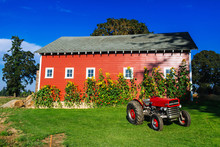 Red Barn During Daytime With V...