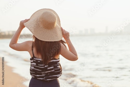 Beach Summer Holiday Vacation Traveling Relaxation, Young woman with hat enjoys her tropical beach vacation