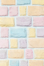 Colorful Pastel Brick Wall Texture Background. Pink, Yellow, Orange Purple And Blue.