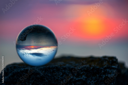 Fotobehang Oost Europa Upside down sunset landscape at Cape Kaliakra, Bulgaria, Eastern Europe - reflection in a lensball - selective focus, space for text