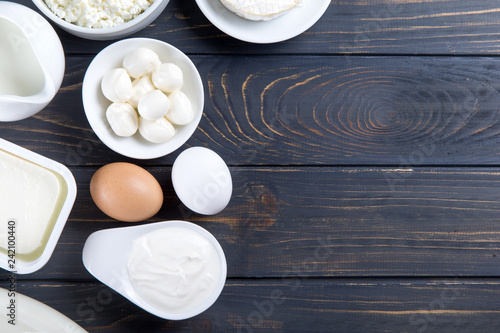Poster Dairy products dairy products on blue wooden background