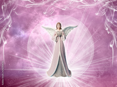 Fotografia angel of love archangel with heart and rays of light over pink mystical backgrou