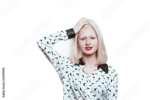 Valokuvatapetti portrait blonde albino girl in studio on white background