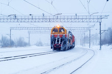 Railway Snow Machine At The Station During Snowfall