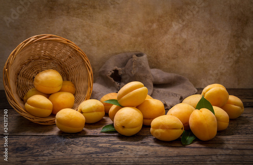 fresh apricots in a basket