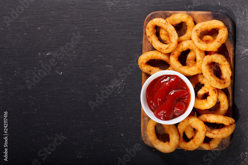 Fototapeta onion rings with ketchup, top view obraz