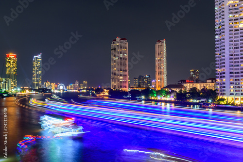 Keuken foto achterwand Stad gebouw blur light of boat moving at the river of City