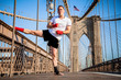 Young athlete fighter exercising on Brooklyn bridge in New York City