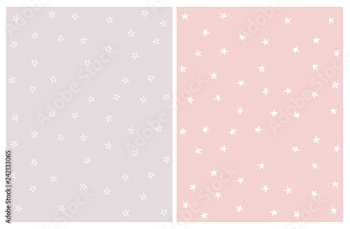 Fototapeta Set of 2 Lovely Hand Drawn Star Vector Patterns. White Irregular Shape Stars on a Light Gray and Pink Background. Cute Infantile Style Nursery Art. Delicate Pastel Colors. obraz na płótnie