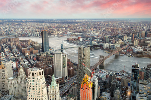 Brooklyn, Manhattan and Williamsburg Bridge at sunset, amazing aerial view of New York City - USA