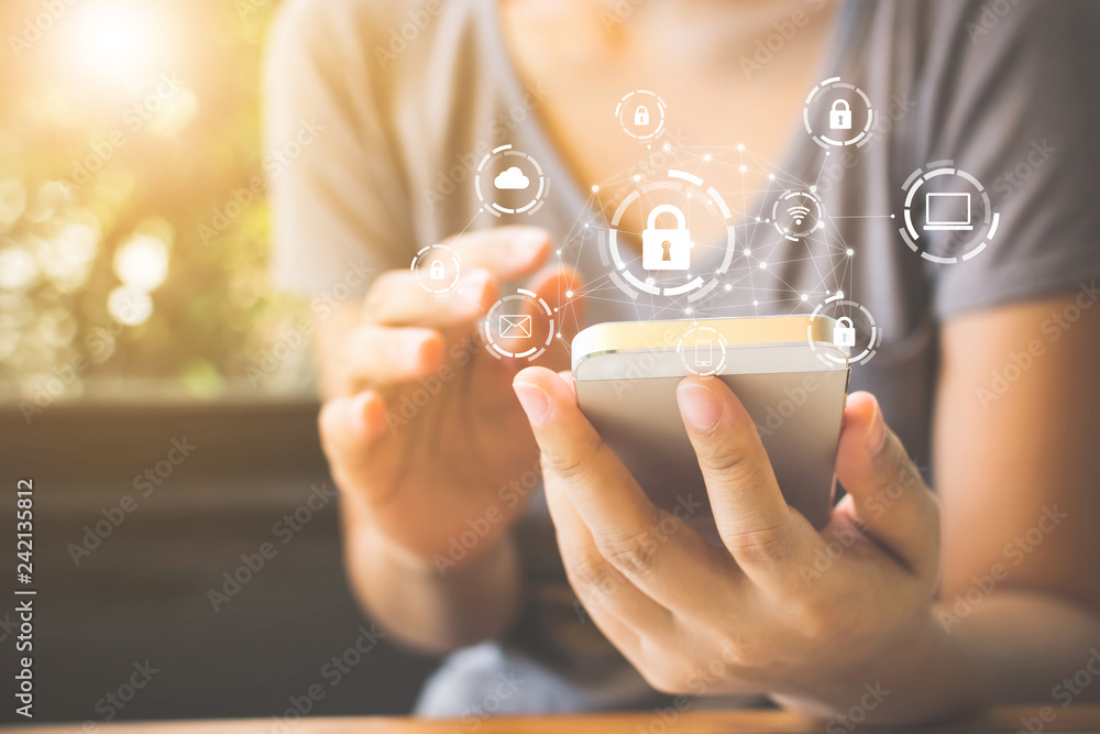 Fototapeta Woman using smartphone with icon graphic cyber security network of connected devices and personal data information