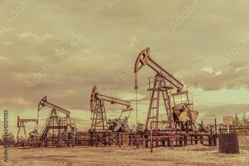 Photo Pump jack. Extraction of oil. Petroleum concept.