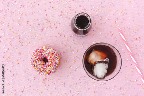 Photo Donut, Cold Brew coffee in a Glass and Jar on Pink Background