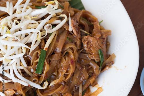 Stir fried rice noodle on plate (Korat's stir fried noodle)