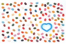 Jelly Bean Sweets Frame Background With Festive Heart. Love And St Valentines Celebration Concept Flat Lay