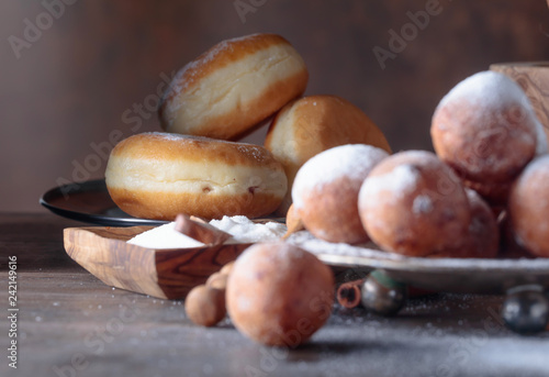 Sweet donuts with cinnamon sticks powdered with sugar.
