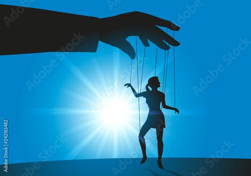 Photo  symbole de la femmes soumise avec une main d'un homme dirigeant une femme comme une marionnette qui doit lui obéir