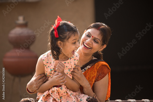 Valokuva  portrait of loving Indian mother and daughter at village